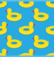 yellow rubber duck swimming circle vector image