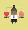 african businessman with heart and brain on scales vector image vector image