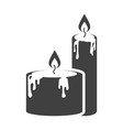 icon of two candles standing next to each other vector image