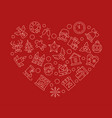 xmas attributes in heart shape linear vector image