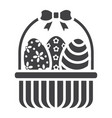 easter eggs in basket glyph icon easter vector image