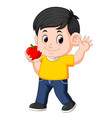 happy boy biting the apple vector image vector image