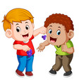 a boy is feeding his best friend with grape vector image vector image