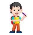 boy holding pencil vector image vector image