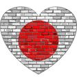 Flag of Japan on a brick wall in heart shape vector image vector image