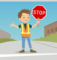 little boy in crossing guard uniform in the street vector image vector image