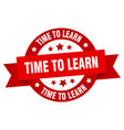 time to learn ribbon time to learn round red sign vector image vector image