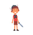 smiling boy dressed as knight cute kid playing vector image vector image