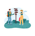 woman and man hiker standing near direction sign vector image vector image