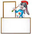 cartoon rabbit painting in an empty board vector image vector image