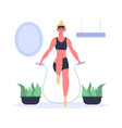 fit girl doing exercises with jumping rope at home vector image