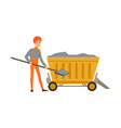 male miner working in mine with wheelbarrow and