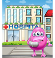 A monster standing in front of the hospital vector image vector image