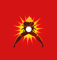 superhero creating an energy blast through his vector image vector image