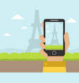 hand holding smartphone with eiffel tower on the vector image