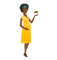 pregnant woman holding a cupcake vector image vector image