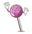waving lollipop with sprinkles character cartoon vector image