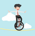 businessman riding unicycle on a rope vector image vector image