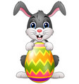easter bunny painting easter egg vector image vector image