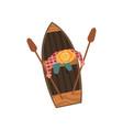 man in hat rowing wooden boat top view vector image vector image