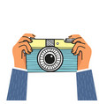 hand holding camera flat design vector image