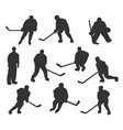 ice hockey players silhouettes set vector image