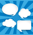 four blank speech bubbles on blue background vector image vector image