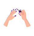female hands with neat blue manicure hold brush vector image vector image