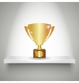 Realistic winners cup on shelf vector image