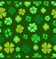 seamless green clover leaf decorative on a dark vector image