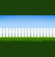 white fence with green grass and blue sky vector image vector image