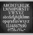 hand drawn sketch font on blackboard background vector image