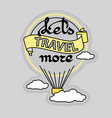 slogan let s travel more and hot air balloon vector image