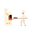 a young caucasian male baker in bakery or kitchen vector image