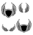 set of the emblems with wings vector image