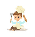 cute little boy chef with whisk and rolling pin vector image vector image