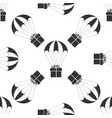 gift box flying on parachute icon seamless pattern vector image vector image