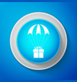 white gift box flying on parachute icon isolated vector image vector image