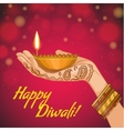 Card for Diwali with diya decoration in woman hand vector image