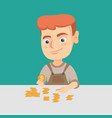 caucasian boy counting coins on the table vector image vector image