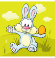easter bunny sitting on green grass holding egg vector image vector image