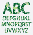tropical alphabet made of banana palm leaves vector image vector image
