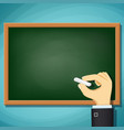 human hand writing in chalk on blackboard vector image vector image