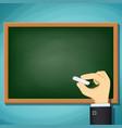 human hand writing in chalk on blackboard vector image
