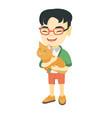 asian happy boy holding a ca vector image vector image