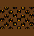 black pumpkin on brown background vector image