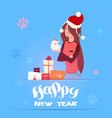 woman in santa hat holding cute pomerian dog vector image