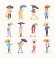 people with umbrellas set characters walk in vector image