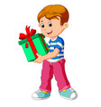 little boy holding a gift box vector image vector image
