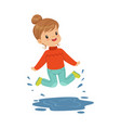 cute happy little girl playing on a puddle wearing vector image vector image